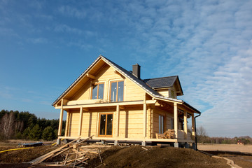 building a house with wooden logs,