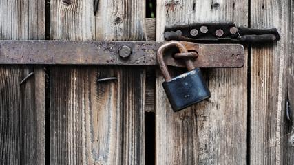 Padlock on the wooden door