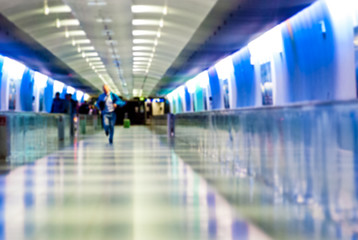 abstract blurry picture of man running at the airport, hurry concept