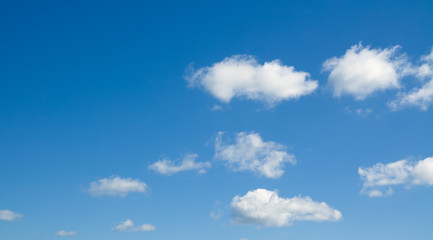 White heap clouds in the blue sky. Cloudscape over horizon.