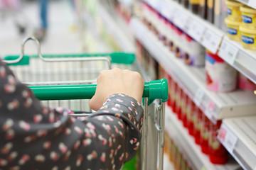 Closeup woman shopping in supermarket