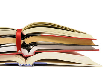 Small pile of open books with red bookmark ribbon isolated on white
