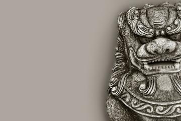 Buddhist stone statue. Guardian Lion Foo Fu dog guard.