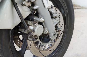 Rear motocycle disc brake close up.