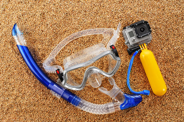 Scuba mask and snorkel on the sand.