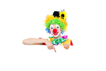 Beautiful young woman as colorful clown