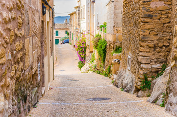 Fototapete - View of a old rustic village alleyway