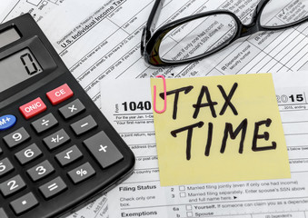 tax form with callculator and glasses