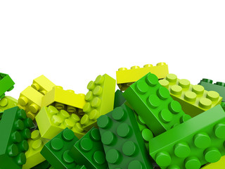 toy plastic bricks background in green and yellow