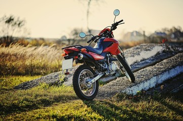 Enduro motorcycle stay on sunset sunshine