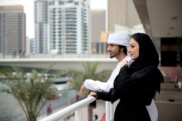 Young Emirati arab couple having conversation