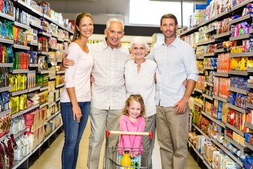 Smiling extended family at the supermarket