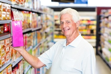 Senior man holding pink box