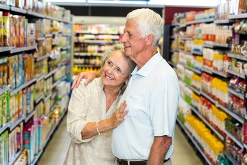 Happy senior couple at the supermarket