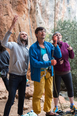 Group of Climbers belays Leader with Mature Coach in the middle