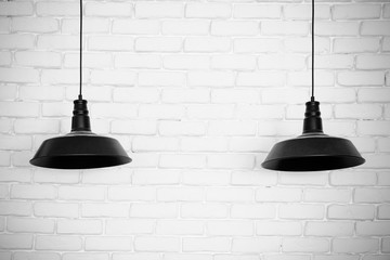 Black ceiling lamps vector. Two black ceiling lamps, light betwe