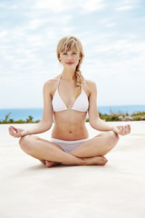 Portrait of beautiful woman in yoga pose