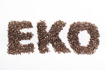 Fototapeta Word eko piled of chia seed on white background.