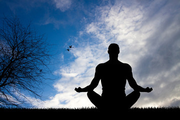 man doing yoga silhouette
