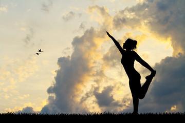 girl in meditation at sunset