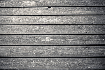 Wooden beach boardwalk with sand for background or texture.