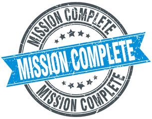 mission complete blue round grunge vintage ribbon stamp