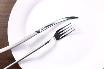 fork and knife with dish