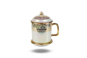 The ancient tea cup elegant gold border floral hand-drawn.