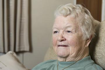 Portrait image of a senior woman indoors.