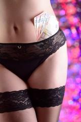 woman prostitute or striptease dancer in black underwear