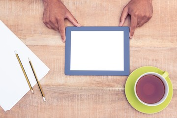 Cropped image of man with digital tablet over table