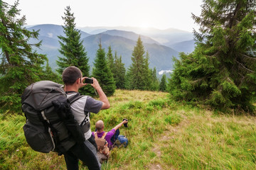 Tourists take pictures of the Carpathian Mountains. Lake Synevir Ukraine.