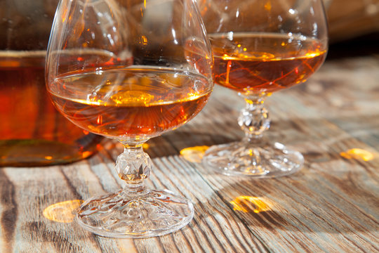 Glasses of cognac and a bottle