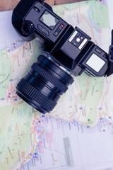Close-up of camera and map