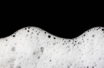 Foam bubbles abstract black background.
