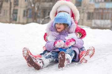 Two girls rolling ice slides