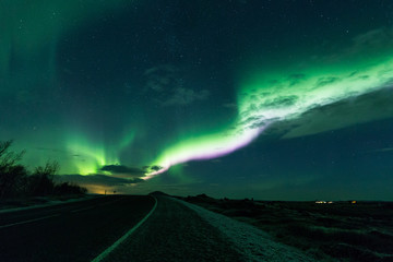Wall Mural - Aurora borealis above a road