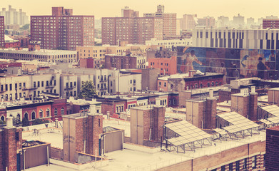 Vintage toned photo of New York residential buildings, Harlem, USA