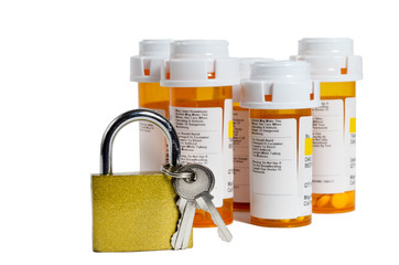 Keep your prescriptions safe and locked up. Selective focus on lock.