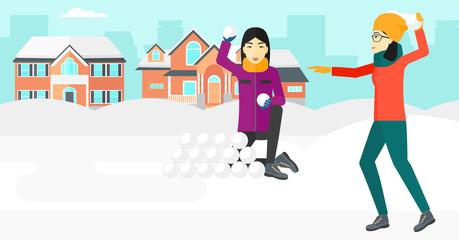 Women playing in snowballs.