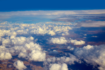 Aerial view of clouds and blue sky while flying