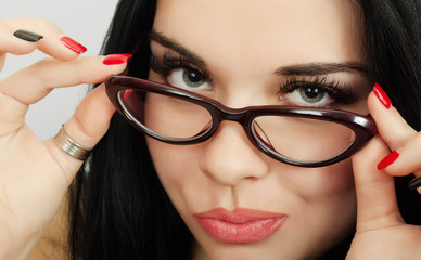 Beautiful brunette wearing glasses close up