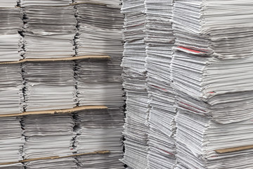 Many stacked bundles of newspapers at printing company