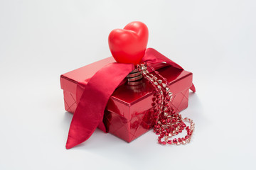 The Holiday - Gift Box with ribbon, bow, heart, chain of hearts  on white background.