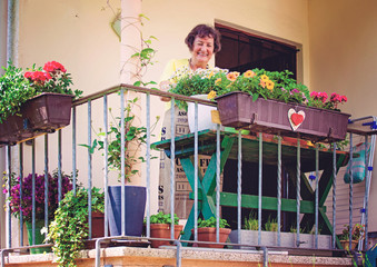elderly woman with her flowers on balcony/gardening 11