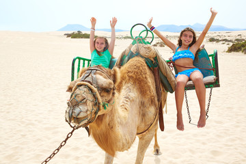 Girls riding Camel in Canary Islands