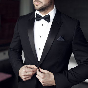Sexy man in tuxedo and bow tie