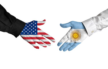 United States and Argentina leaders shaking hands on a deal agreement