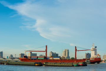 Cargo ship on blue skies background.