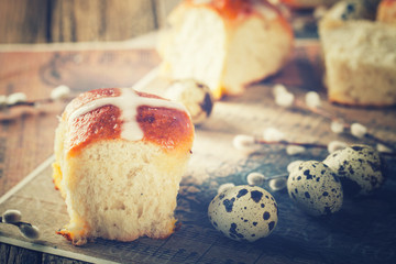 Easter Hot Cross Buns on wooden background.Toned image.Vintage style.selective focus.